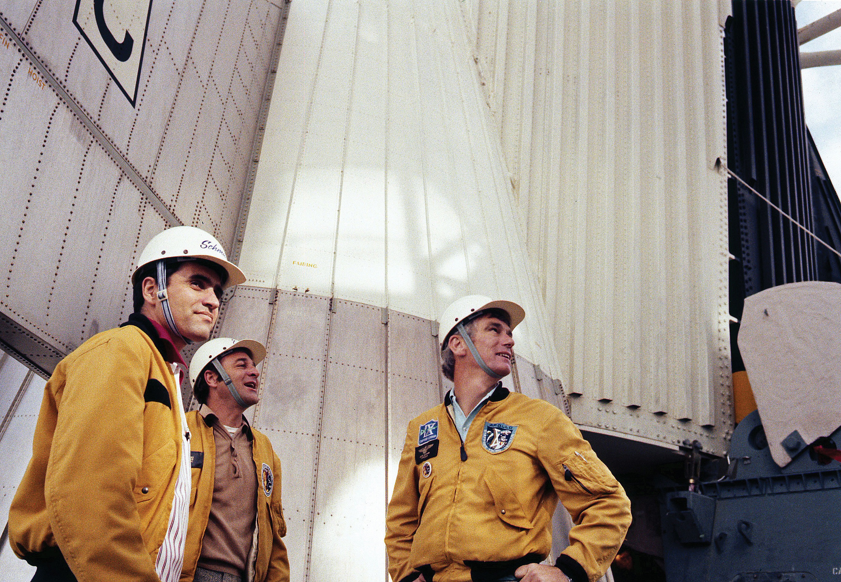 Harrison Schmitt, Ron Evans, and Gene Cernan stand at the base of their Saturn V rocket during a visit to the pad just days before the launch of Apollo 17. Credit: NASA via J.L. Pickering/Retro Space Images