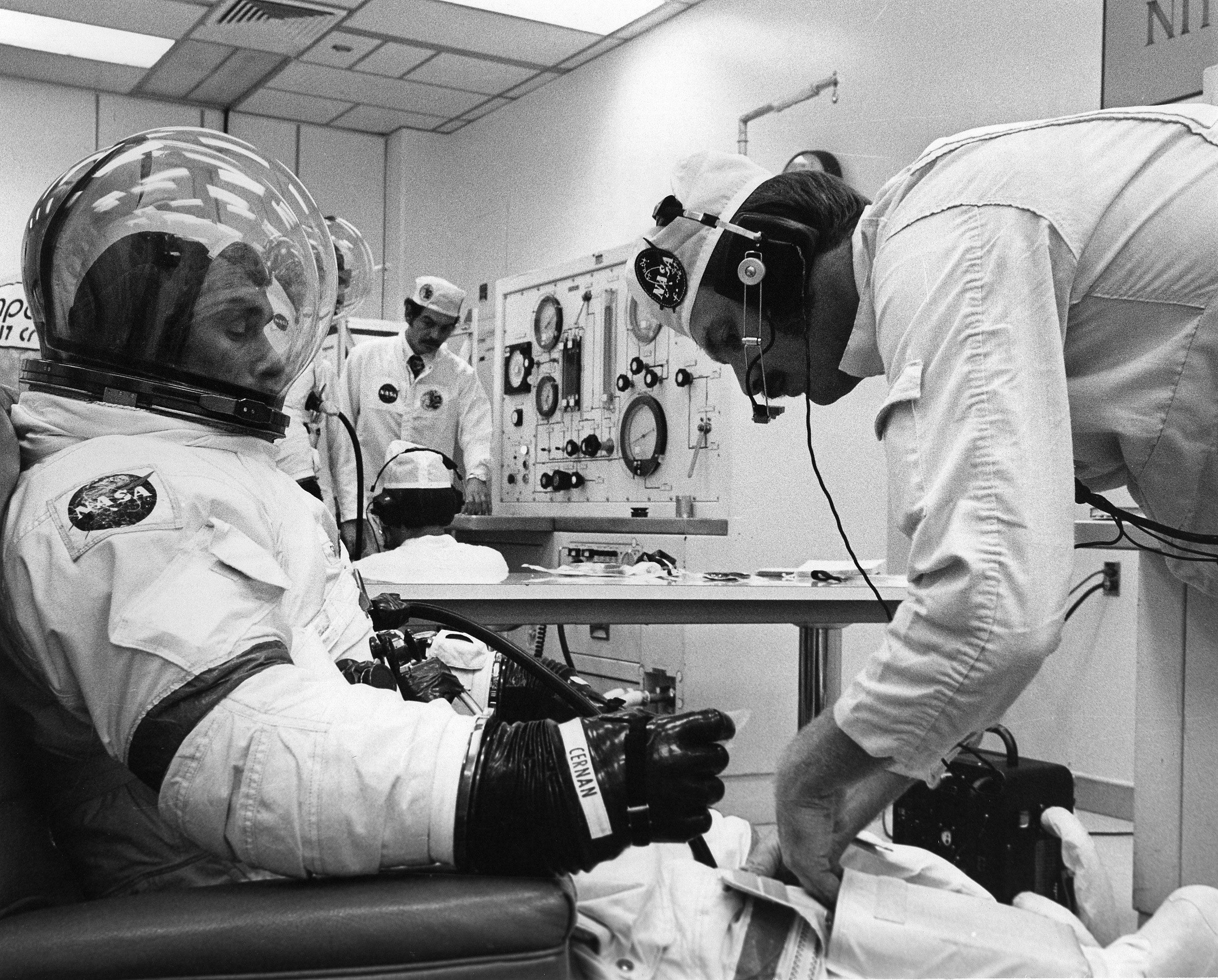 Technicians check Apollo 17 Mission Commander Gene Cernan's spacesuit during preflight preparations before boarding and launch of the Saturn V rocket. Credit: NASA