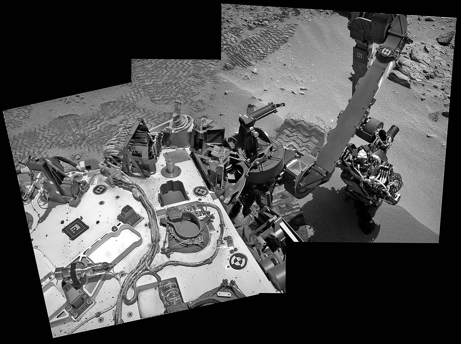 Curiosity scoops up Martian soil sample on Sol 66 (Oct 12. 2012). Navcam image mosaic shows the robotic arm at work during scooping operations. Curiosity later delivered the first soil sample to the circular CheMin sample inlet at the center on the rover deck. Credit: NASA/JPL-Caltech/Ken Kremer/Marco Di Lorenzo