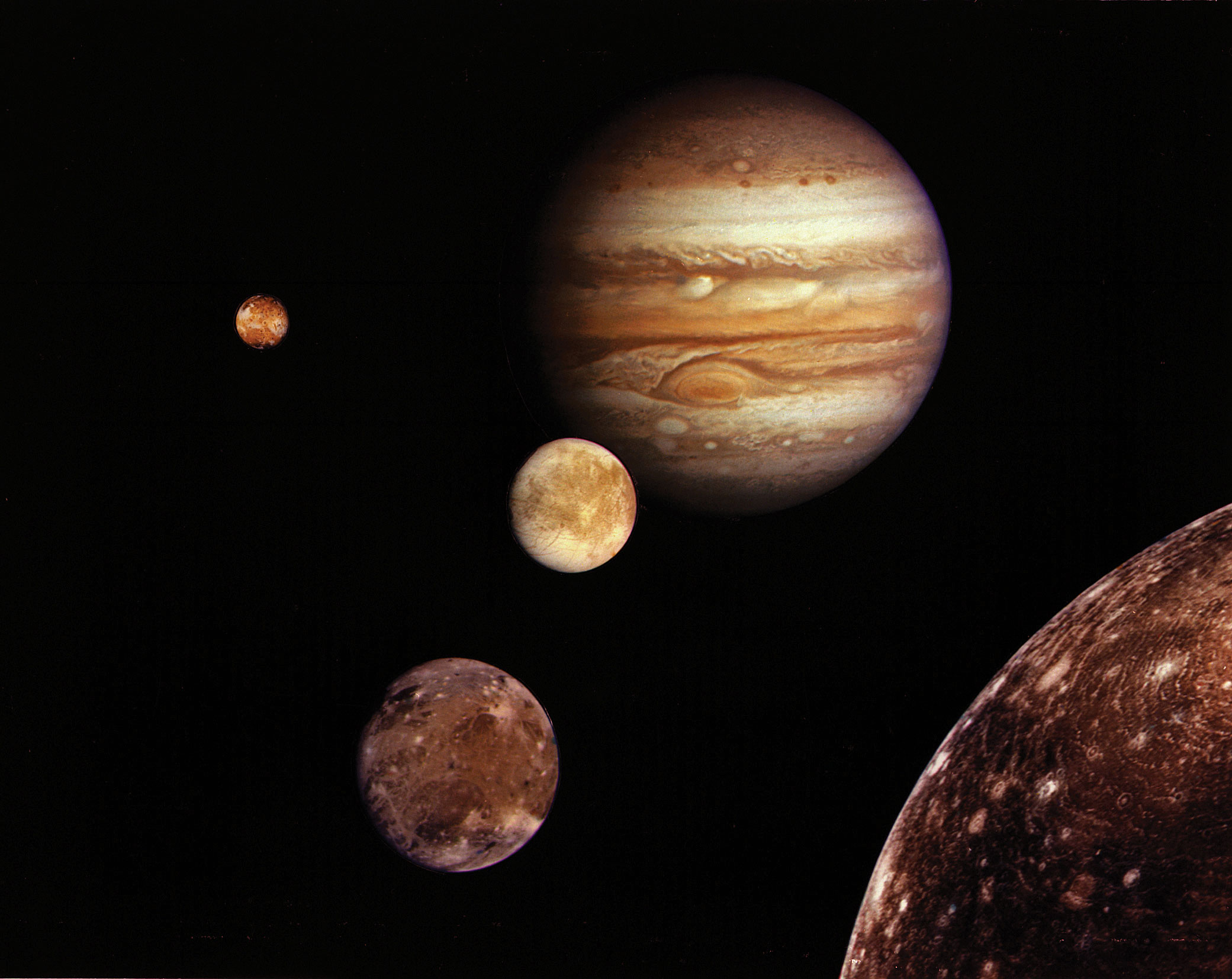 Jupiter and its four planet-size moons, called the Galilean satellites, were photographed in early March 1979 by Voyager 1 and assembled into this collage. They are not to scale but are in their relative positions. Startling new discoveries on the Galilean moons and the planet Jupiter made by Voyager l factored into a new mission design for Voyager 2. Reddish Io (upper left) is nearest Jupiter; then Europa (center); Ganymede and Callisto (lower right). Credit: NASA/JPL