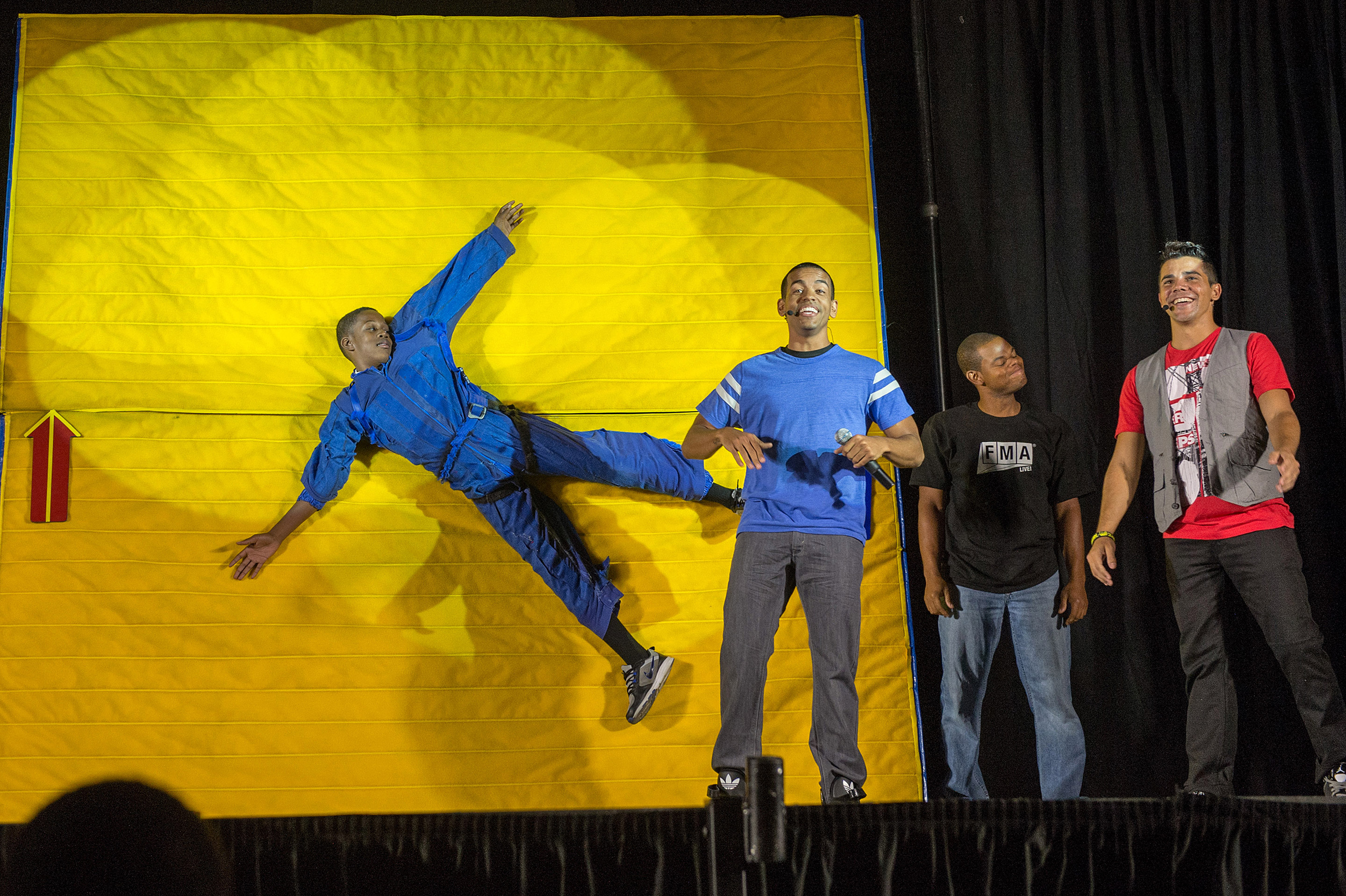 """With the help of a student participant, """"FMA Live!"""" crew members explain Newton's first law of motion at Hardy Middle School in Washington on Sept. 16th, 2013. """"FMA Live!"""" travels across the country and has reached nearly 300,000 students. Image: NASA/Jay Westcott"""