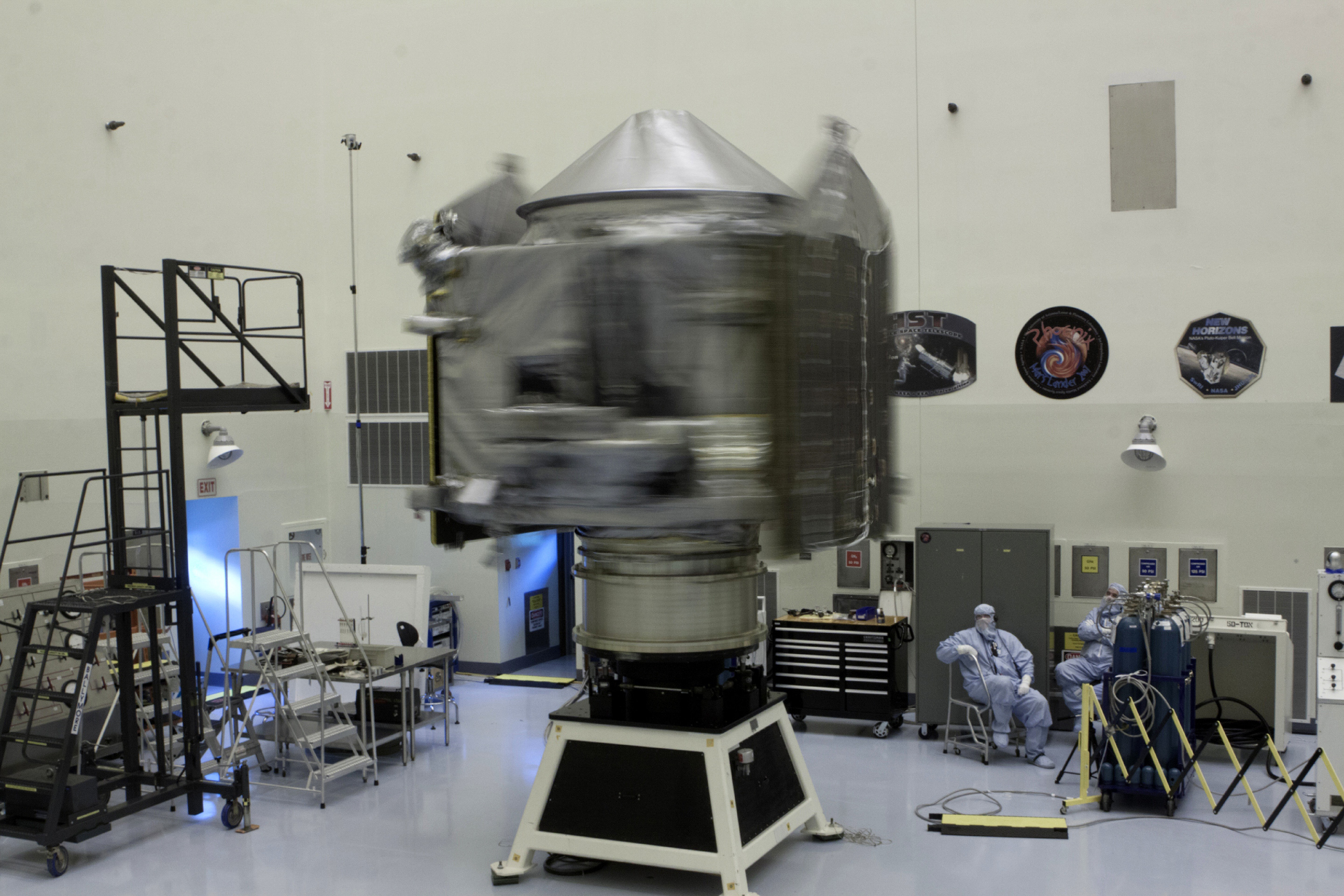 Inside the Payload Hazardous Servicing Facility at Kennedy Space Center in Florida, engineers and technicians perform a spin test of the MAVEN spacecraft. The operation is designed to verify that MAVEN is properly balanced as it spins during the initial mission activities. Photo: NASA/Kim Shiflett
