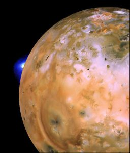 Voyager 1 image of Io showing active plume of Loki on limb. A heart-shaped feature southeast of Loki consists of fallout deposits from active plume Pele. Image credit: NASA/JPL/USGS