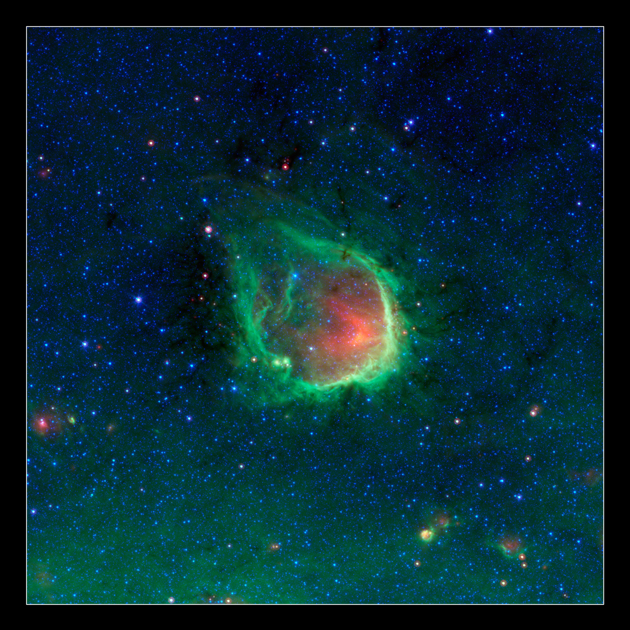 "This glowing emerald nebula seen by Spitzer is reminiscent of the glowing ring wielded by the superhero Green Lantern. Astronomers believe rings like this are actually sculpted by the powerful light of giant ""O"" stars. Named RCW 120 by astronomers, this region of hot gas and glowing dust can be found in the constellation Scorpius. Image: NASA/JPL-Caltech/GLIMPSE-MIPSGAL Teams"
