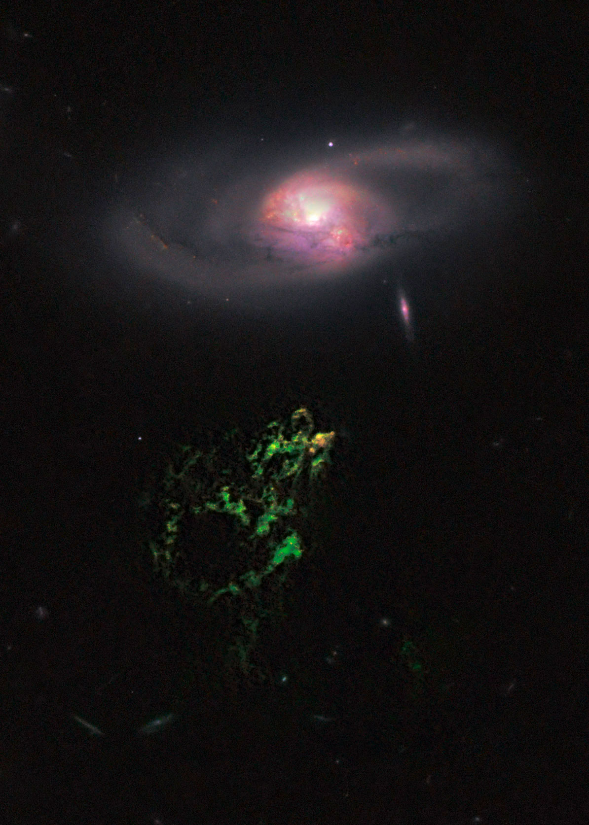 Image #7: A Zooite discovery and a mysterious object: Hanny's Voorwerp which can be seen below spiral galaxy IC2497. Credit: NASA/ESA/W. Keel/Galaxy Zoo Team/Hubble Space Telescope