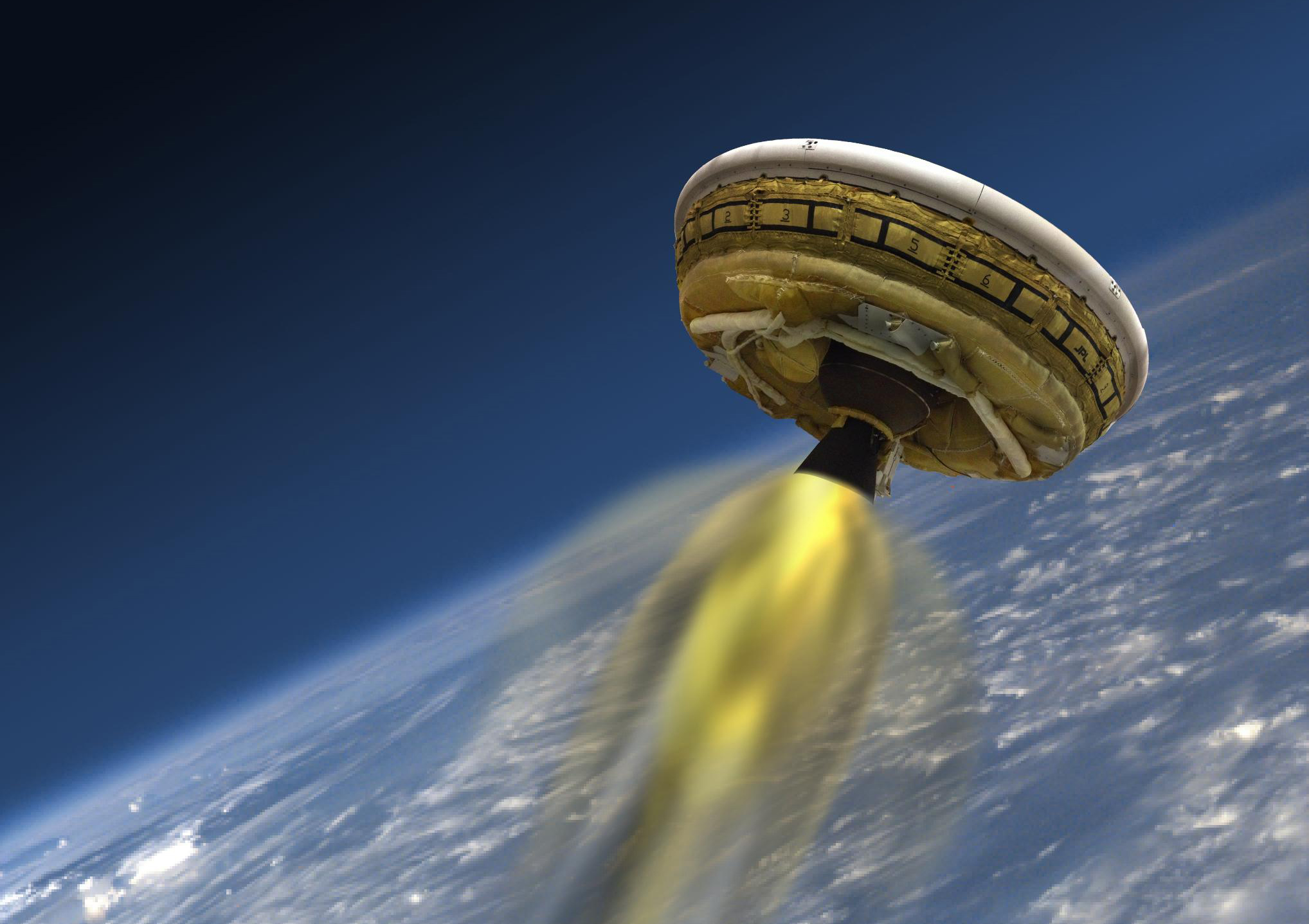 This artist's concept shows the test vehicle for NASA's Low-Density Supersonic Decelerator (LDSD), designed to test landing technologies for future Mars missions. A balloon will lift the vehicle to high altitudes, where a rocket will take it even higher, to the top of the stratosphere, at several times the speed of sound. Credit: NASA/JPL-Caltech