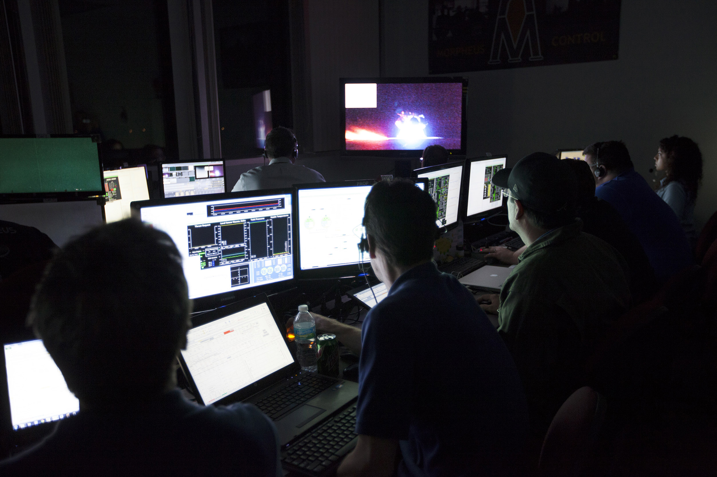 Engineers in the Morpheus Control Room monitor the Morpheus lander as it lifts off on the first free flight test at night. Credit: NASA/Kim Shiflett