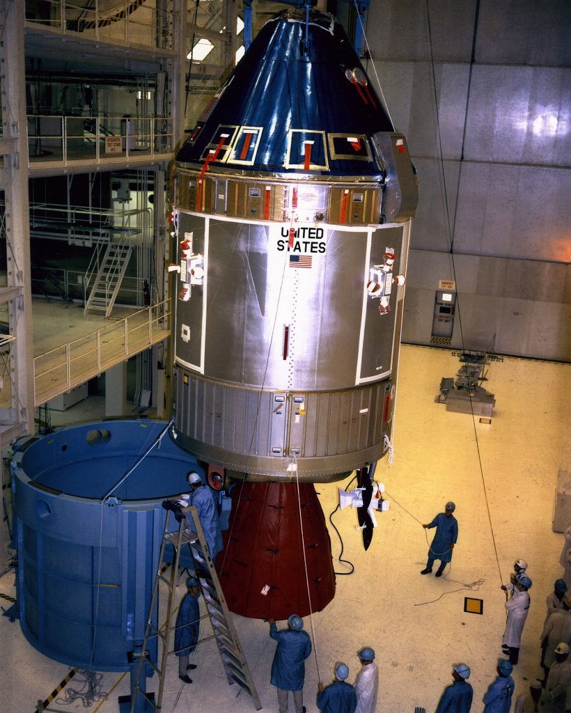 The Apollo Spacecraft 107 Command and Service Modules being moved from workstand 134 for mating to the Spacecraft Lunar Module Adapter (SLA) while inside the Manned Spacecraft Operations Building at KSC during April of 1969.