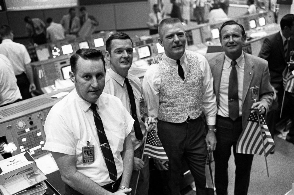 Flags were a common site in Mission Control as they cheered the successful splashdown of Apollo 11 on July 24, 1969.