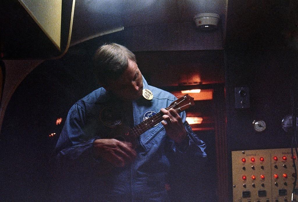 Armstrong strums a ukulele inside the quarantine facility aboard the USS Hornet on July 24, 1969.