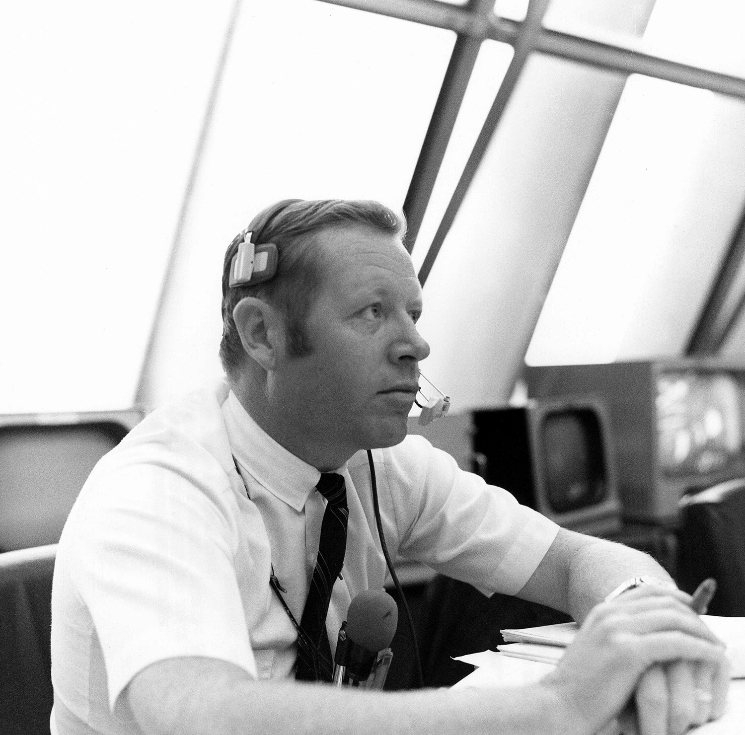 Jack King, KSC Public Affairs Apollo Launch Commentator, follows proceedings of the wet portion of the Countdown Demonstration Test for Apollo 12 from his console within Firing Room 2 of the Launch Control Center. Credit: NASA via Retro Space Images