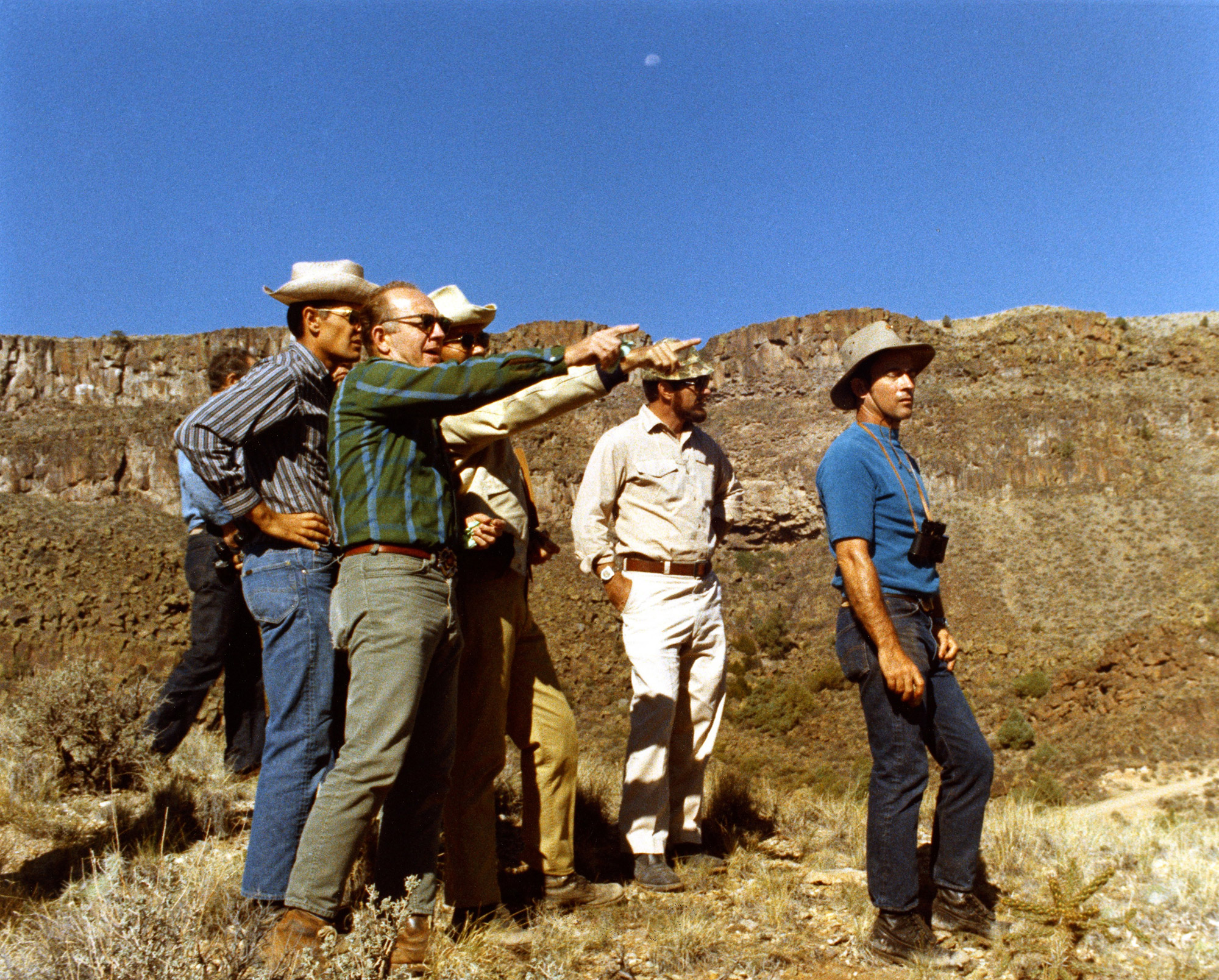 Lee Silver points out some geological observations to his astro-geologists in training, Charlie Duke and John Young. Credit: NASA/U.S. Geological Survey via Retro Space Images