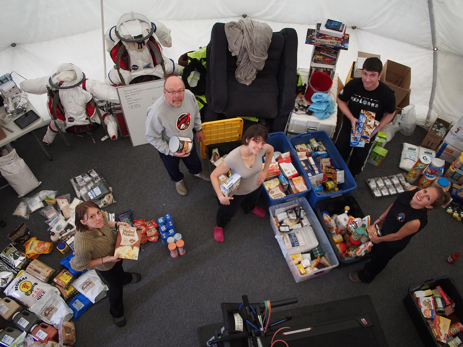 HI-SEAS crew members Tiffany Swarmer, Ron Williams, Lucie Poulet, Casey Stedman, and Annie Caraccio unpack crates of food for the current mission. Credit: Ross Lockwood