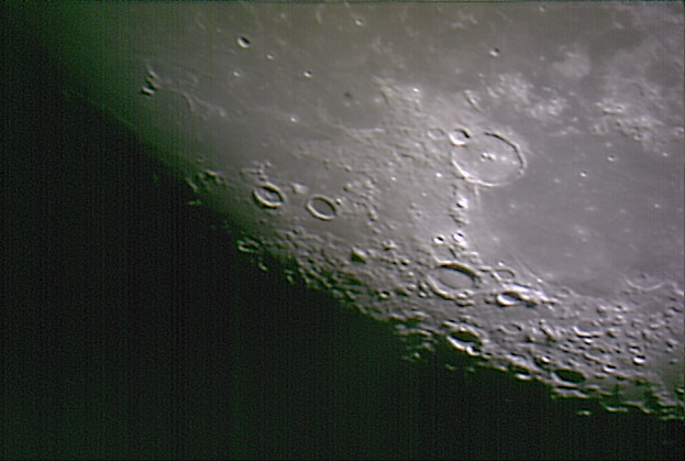 Using a cheap webcam the surface details of the moon can be seen clearly. Credit: Mike Barrett