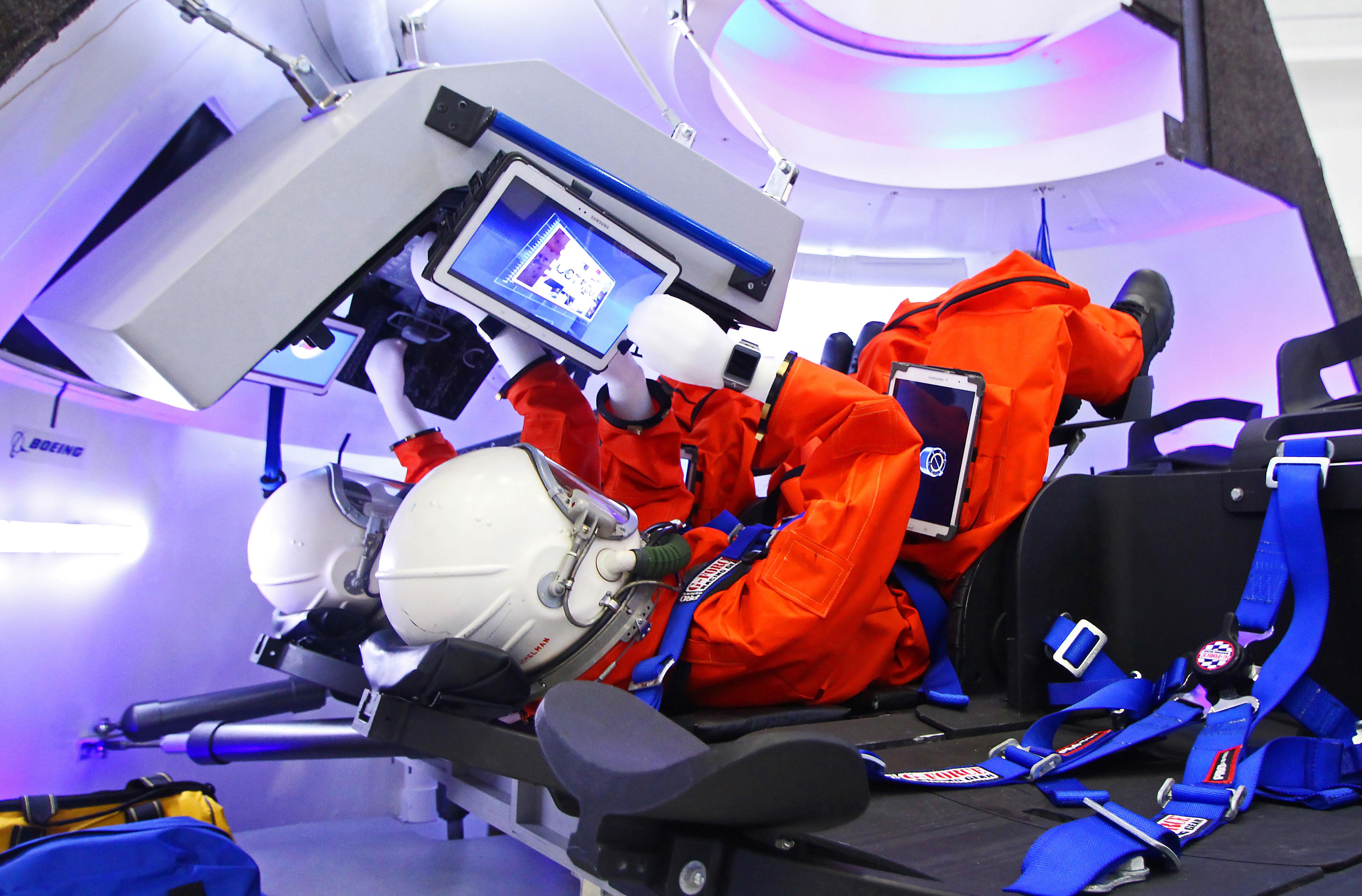 Taking a peek inside Boeing's new high-tech CST-100 mock up test article. Credit: Mike Killian