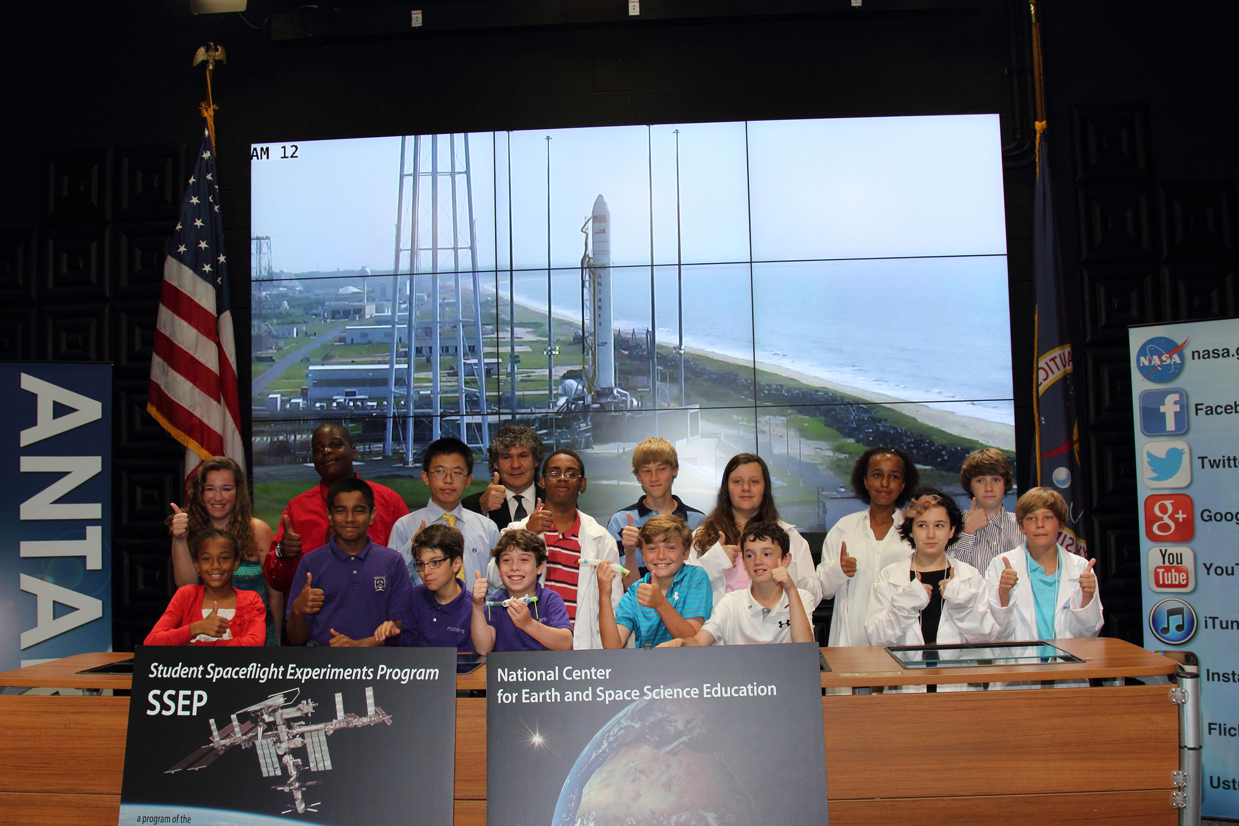 Students from some of the participating SSEP schools stand with program founder, Dr. Jeff Goldstein, the morning of the Antares Orb-2 launch. The students watched their experiments soar into space that same day with much anticipation. Credit: Lloyd Campbell