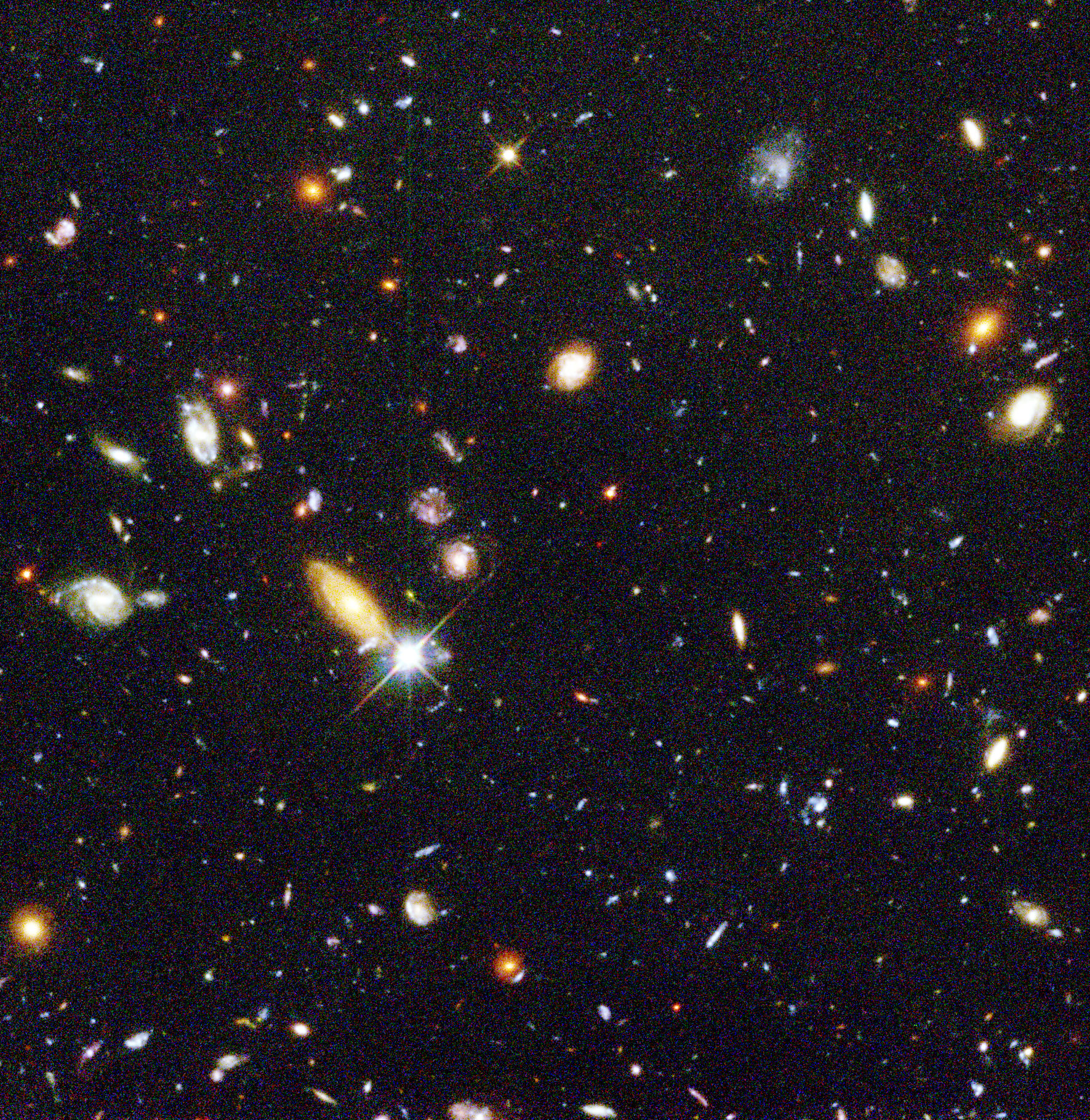 """Representing a narrow """"keyhole"""" view of the universe, the original Hubble Deep Field image covers a speck of the sky only about the width of a dime 75 feet away. Credit: Robert Williams, Hubble Deep Field Team (STScI), NASA"""