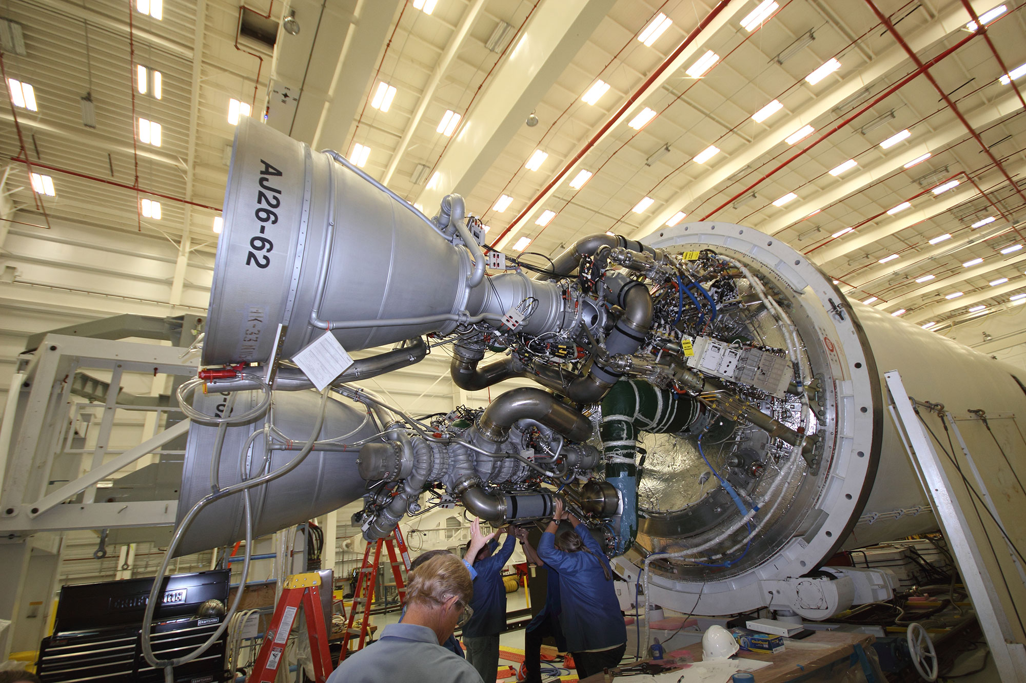 Orbital Sciences' technicians at work on two AJ26 first stage engines at the base of an Antares rocket at NASA Wallops. The refurbished, Soviet era NK-33 engines most likely caused the Antares rocket failure in late 2014. Credit: Ken Kremer