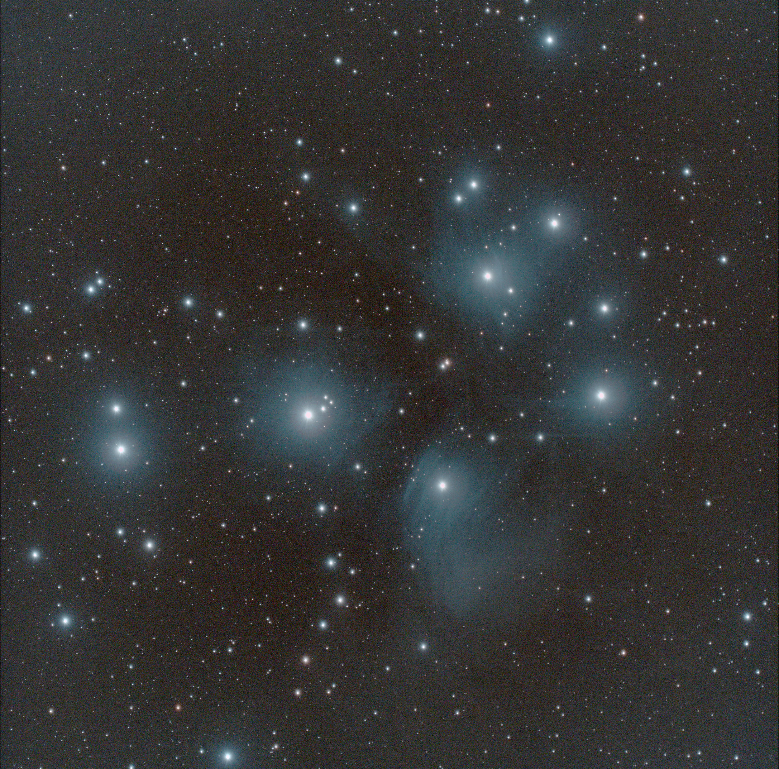 M45 the Pleiades, an Open Cluster visible to the naked eye. Credit: Mike Barrett