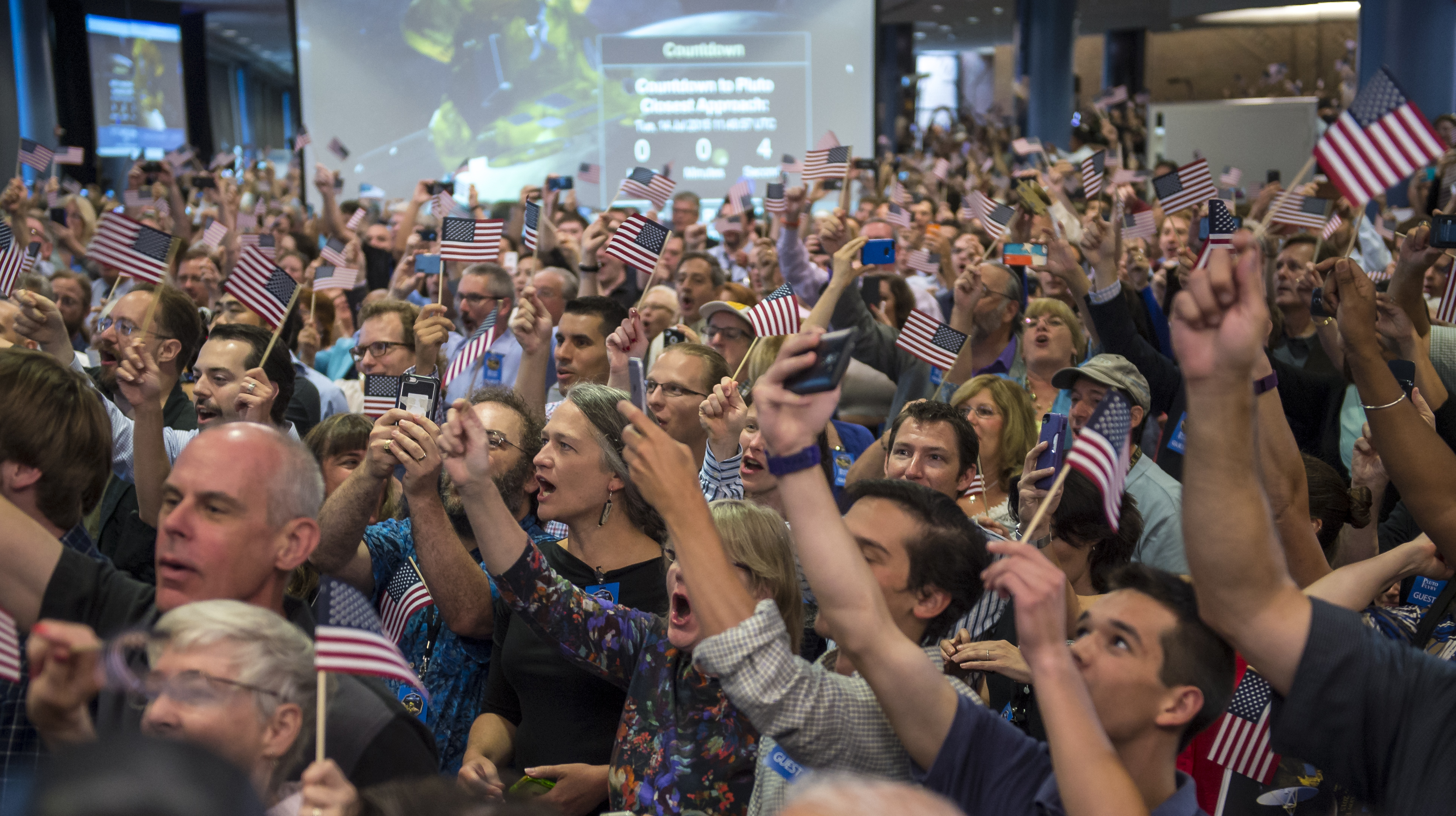 Guest and New Horizons team members countdown to the spacecraft's closest approach to Pluto, Tuesday, July 14, 2015 at the Johns Hopkins University Applied Physics Laboratory (APL) in Laurel, Maryland. Credit: NASA/Bill Ingalls