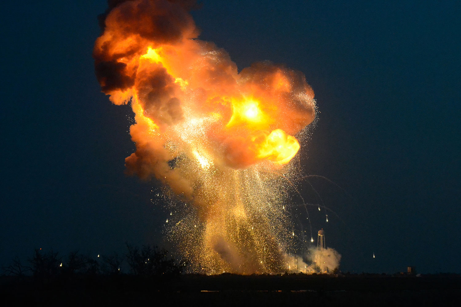 Seconds after liftoff, the ORB-3 Antares rocket fell near the launch pad due to an apparent failure in the turbopump supplying fuel to one of the two first-stage engines. Range Safety Officers engaged the Flight Termination System to stop the remaining engine. Credit: Elliot Severn
