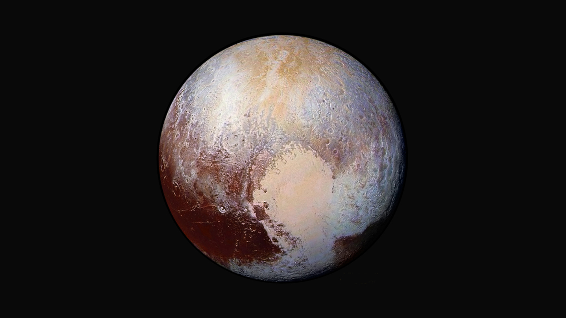 Figure 1: Iconic image – the enhanced-colour portrait of Pluto taken by New Horizons' Long Range Reconnaissance Imager (LORRI) from a distance of 450,000 km (280,000 miles). Centred on the 'heart' of Tombaugh Regio, it shows features as small as 2.2 km (1.4 miles). Four images were combined with colour data from the Ralph instrument to create this view. Credit:NASA/JHUAPL/SwRI